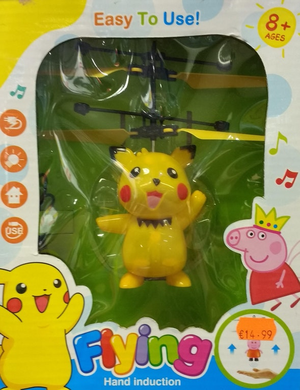 A flying toy of pikachu with unusual cartoons on the cover which are not pokemon. Another bootleg pokemon toy