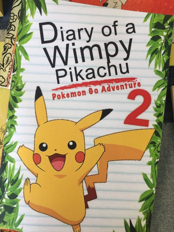 A book titled: Diary of a Whimpy Pikachu.