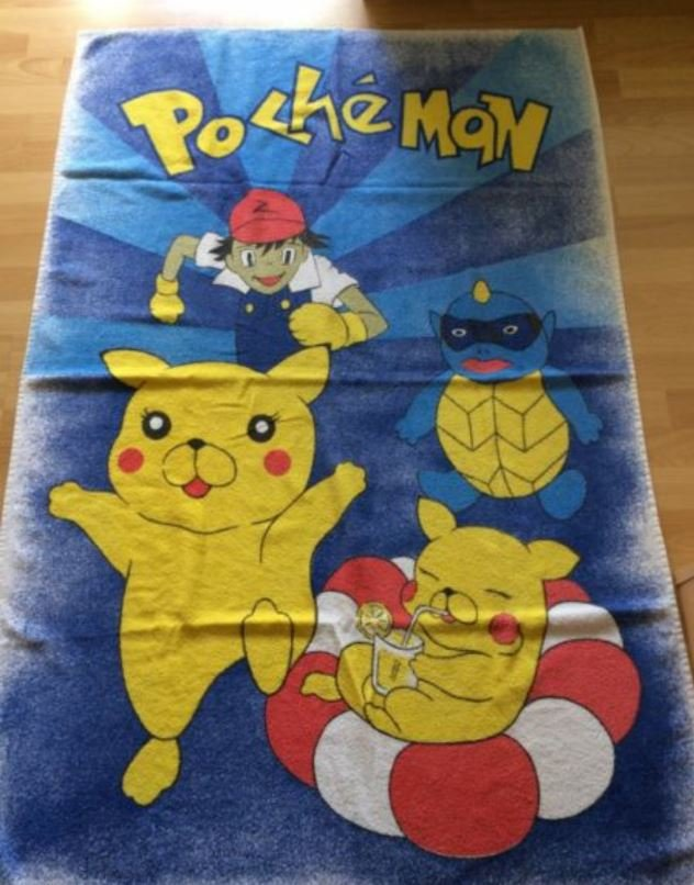 A towel that looks like it has pokemon cartoons on it however it is off brand and says Pocheman instead.